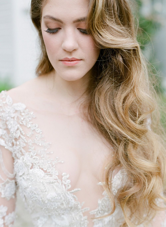 elegant waves bridal hair swept to one side side swept up do