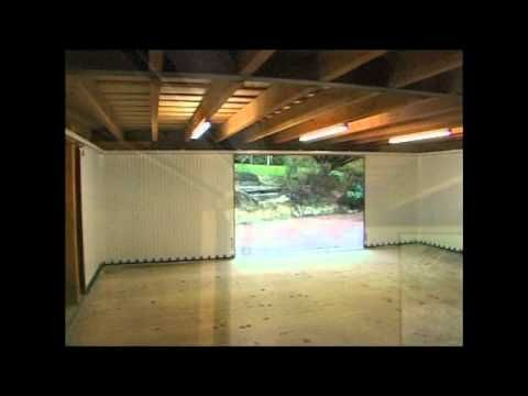 We Offer A Fantastic Selection Of Sliding Garage Doors For More Information And Examples Please Bro Sliding Garage Doors Garage Doors Side Hinged Garage Doors