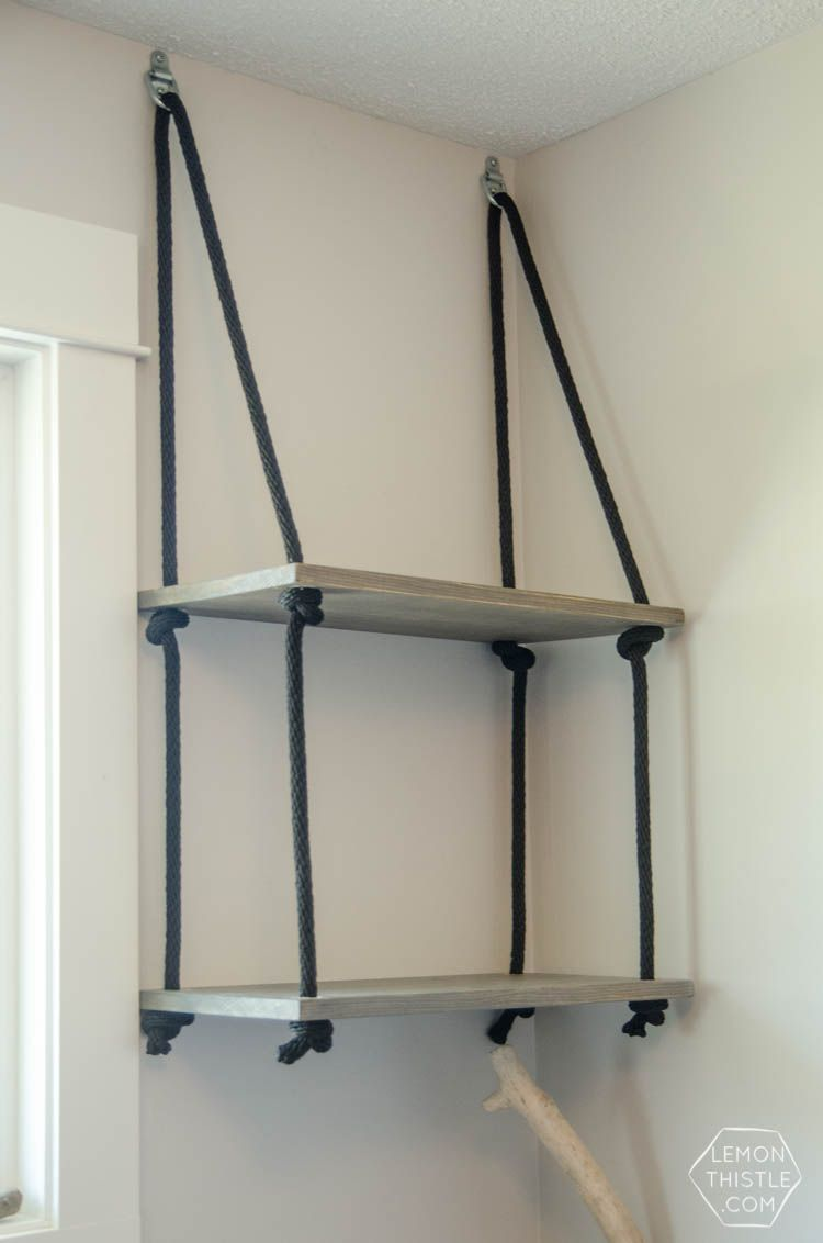 Hanging Shelves diy hanging rope shelving- such a fun alternative to a bookshelf