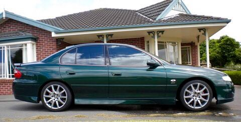 2002 Holden 'HSV' Senator 300. This Australian manufactured sedan looks understated and maybe a bit dull. It lacks the big spoilers and body kits of it's Clubsport, GTS, and SV300 counterparts however under the bonnet lied a 300kw 5.7l C5 Chevrolet Corvette Callaway tuned V8. Making it one of the most powerful naturally aspirated luxury sports sedans in automotive history.