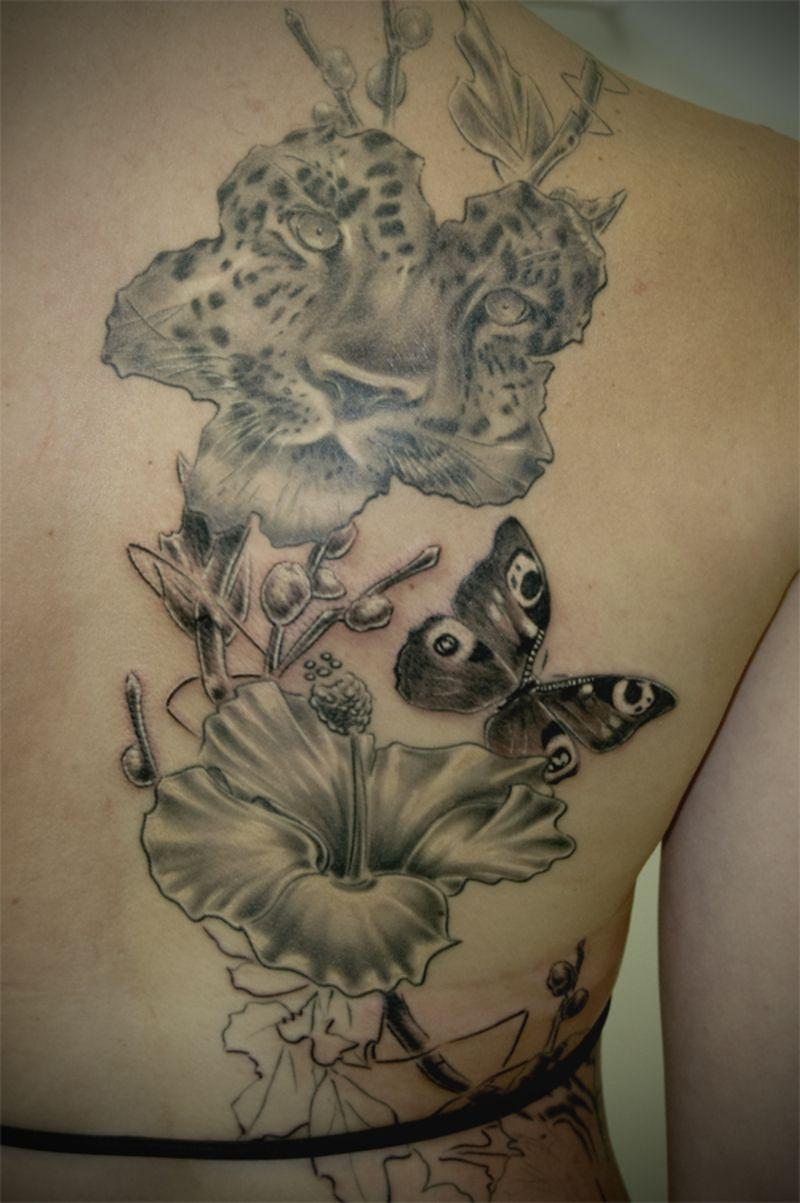 Flower tattoos leopard face butterfly and flowers tattoo on back