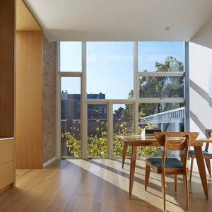 Doblin house addition living room floor to ceiling windows also home in