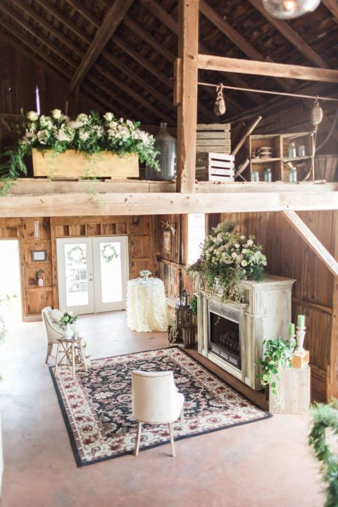 A mantel overflowing with flowers and vintage goods are must-haves for a country wedding at a rustic barn.
