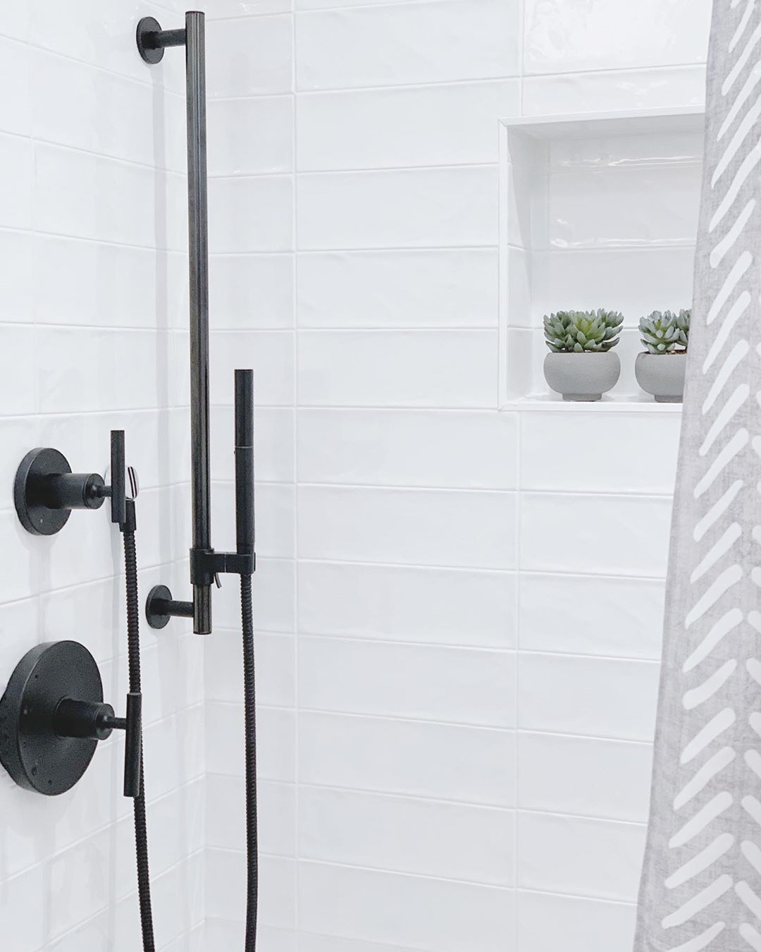 All White Shower Tile With Black Fixtures