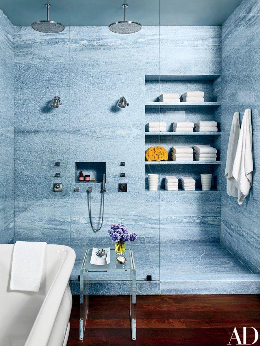 Blue quartz lines the master bath, where Bierman created a storage ...