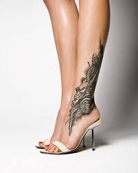 leg tattoo women. Like the shape and placement