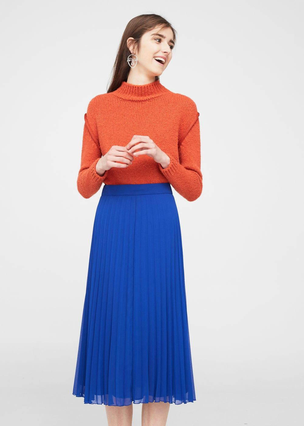 Simple, classy way to dress up your Mets colors! This look from MANGO incorporates the pleated skirt and mock turtleneck trends of this year, and the details shine with the simple orange and blue color blocking.