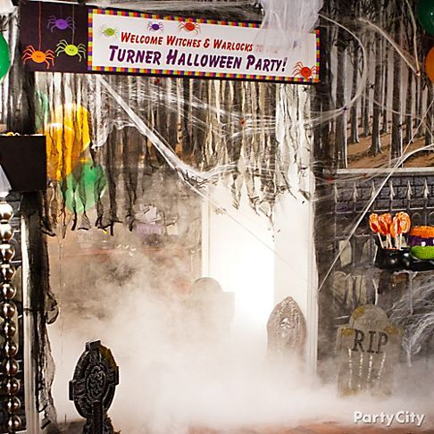 Cast a spell with an eerie entrance Nothing says spooky like an - halloween party ideas decorations