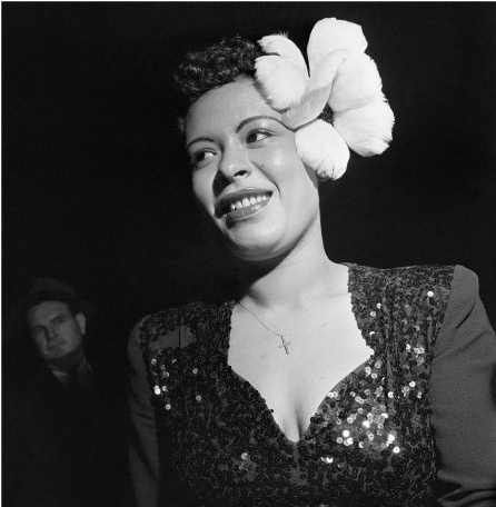 Billie Holiday wears a large white flower in her hair for a performance in New York City 1940s. Photo Bradley Smith.