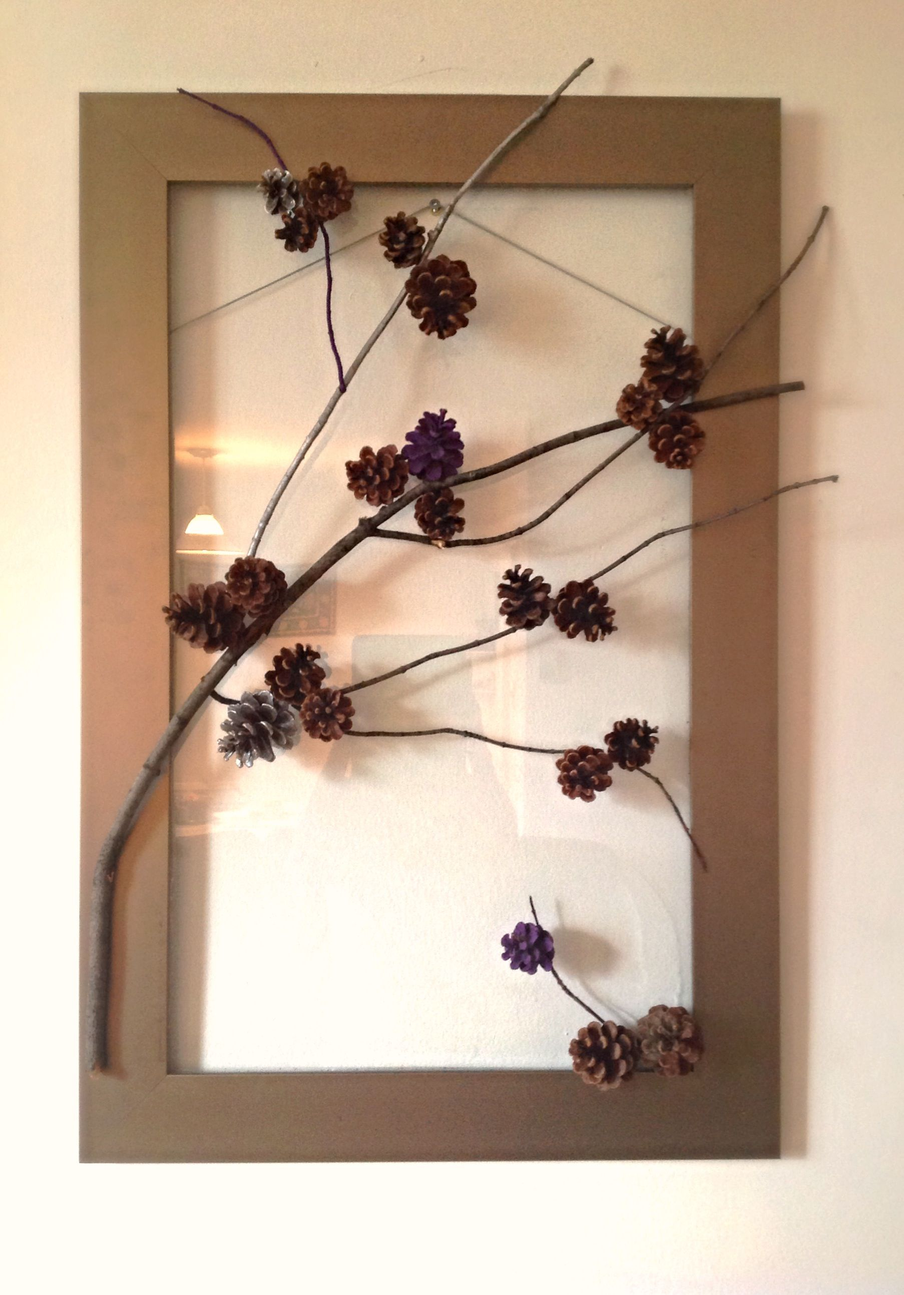 Diy Pine Cone Wall Art Made This Using Empty Glass Frame Pines And Twigs That I Found Outside Tree Branch Decor Cones Diy Stick Art