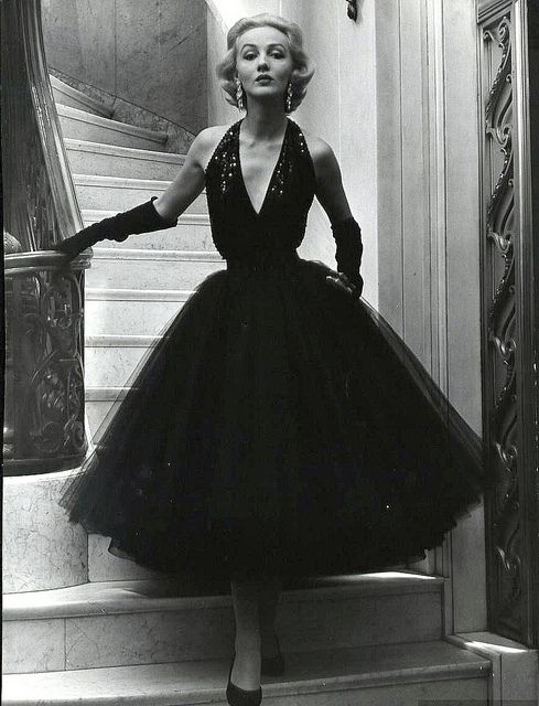 1951 ~ Short evening dress with sequined halter top and yards of tulle for the bouffant skirt by Traina-Norell, photo by Nina Leen