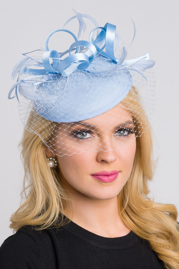 606fe8d4 Be the envy of the party in this elegant felt fascinator. The round felt  base is covered with satin ribbon loops, adorned with flighty feathers and  topped ...