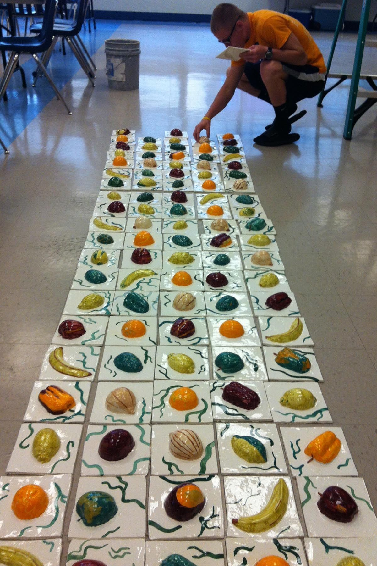 High school ceramic artists create a tile mural for the