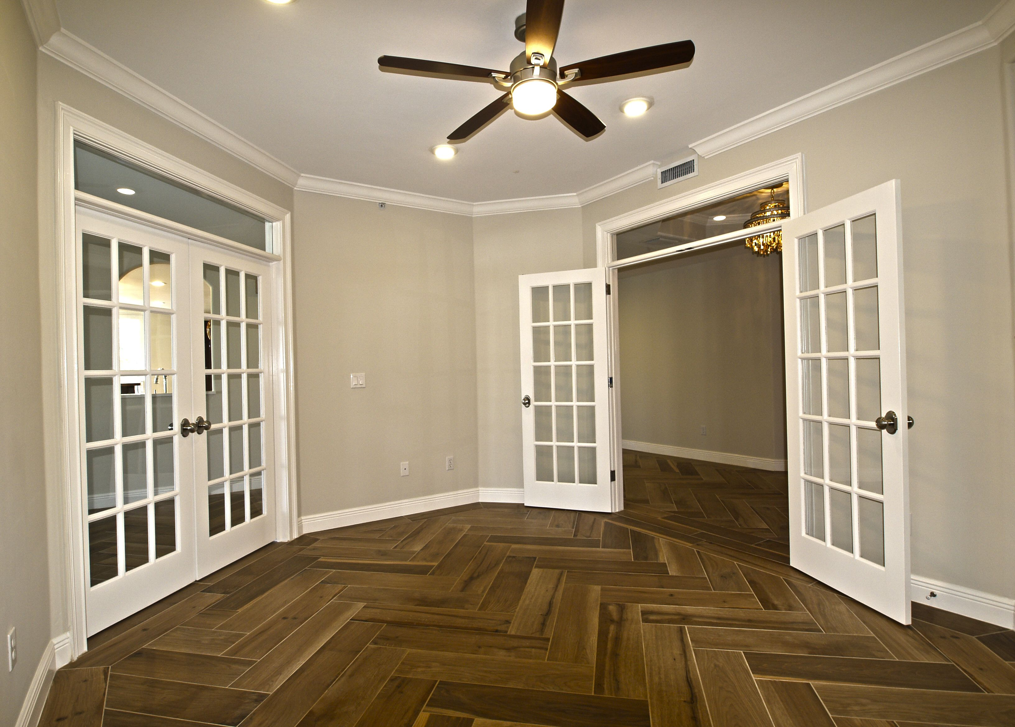Beautiful Den with double french doors high end porcelain floors