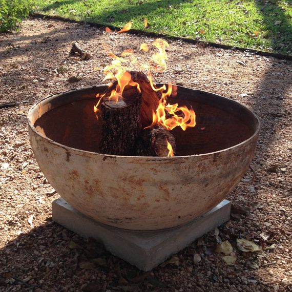 Base of an old propane tank and a concrete pedestal to sit it on.  Brilliant! I could totally make one of these myself! | Modern Handmade Fire  Pit - Base Of An Old Propane Tank And A Concrete Pedestal To Sit It On