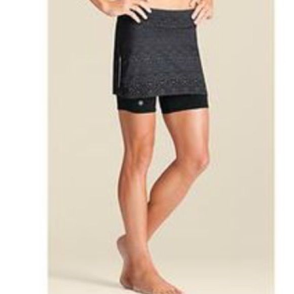 Athleta Skirt Comfortable mid rise Athleta skort with reflective trim on sides and back small pocket for keys. Great hidden drawstring to keep skort in place while you workout. Shorts have silicone leg grips. Machine wash. In great condition. Athleta Shorts Skorts