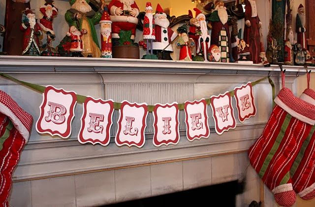 20  Fabulously Free Christmas Printables - I have a similar Santa mantle and stockings, just need the banner!