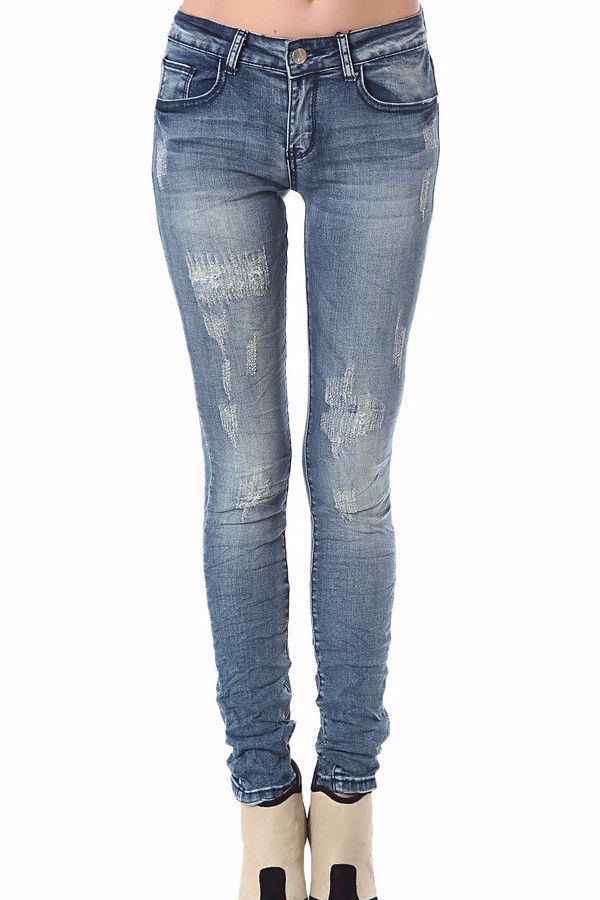 Distressed Skinny Jeans in Mid-Blue Wash with Light Fading