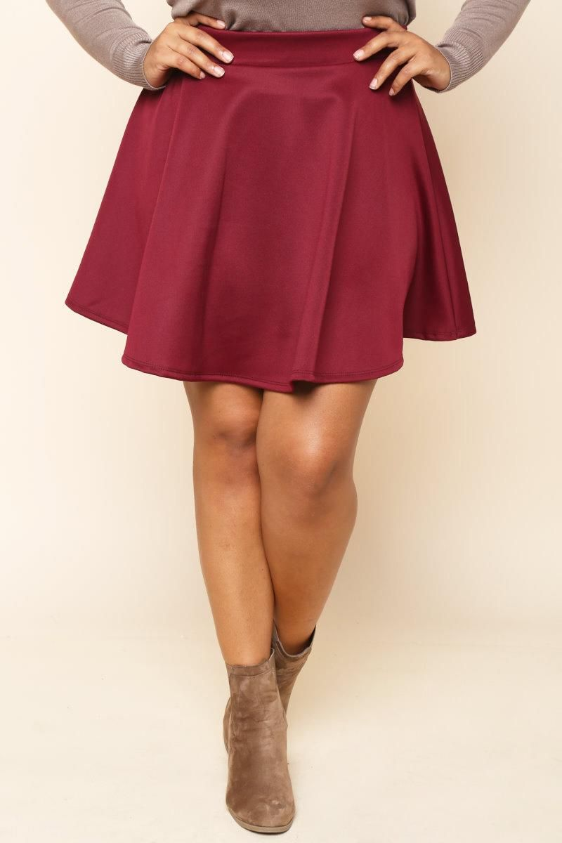 A plus size skater skirt made with scuba materials. A-line build and finished with flared hem.