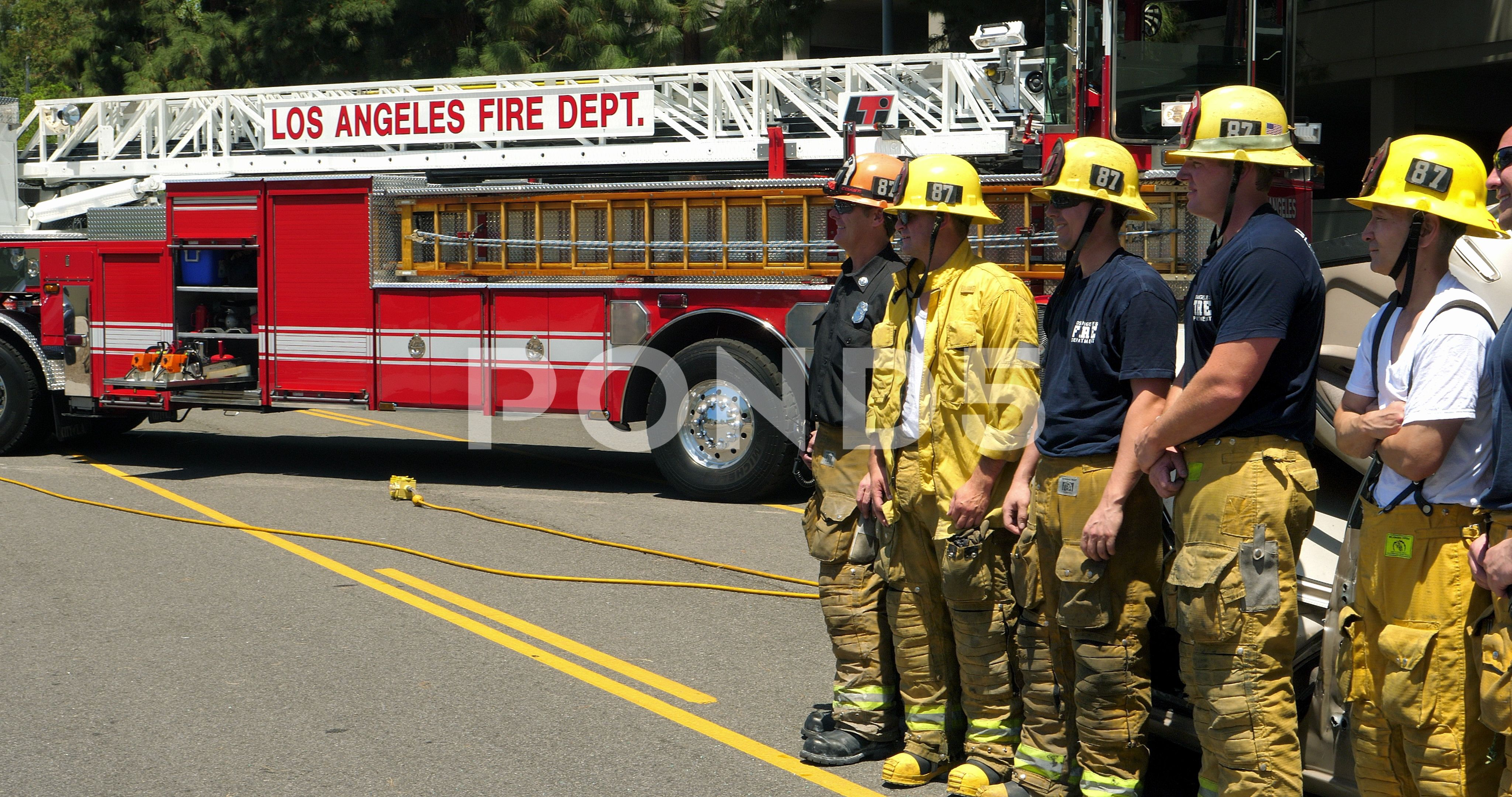 Los Angeles Fire Department Firefighters Relax After Rescue