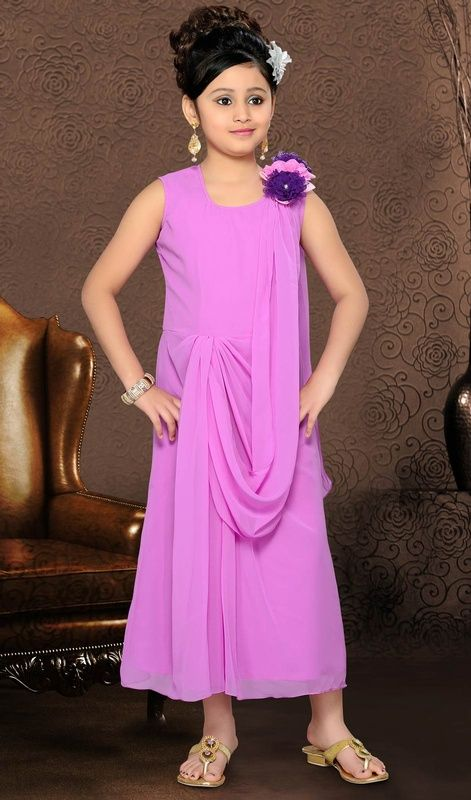 We unfurl our the intricacy and exclusivity of our creations highlighted in such a charming lavender shade faux georgette gown. The ethnic fancy embellishments work in gown adds a sign of magnificence statement with your look. #DivinePurppleColorGown