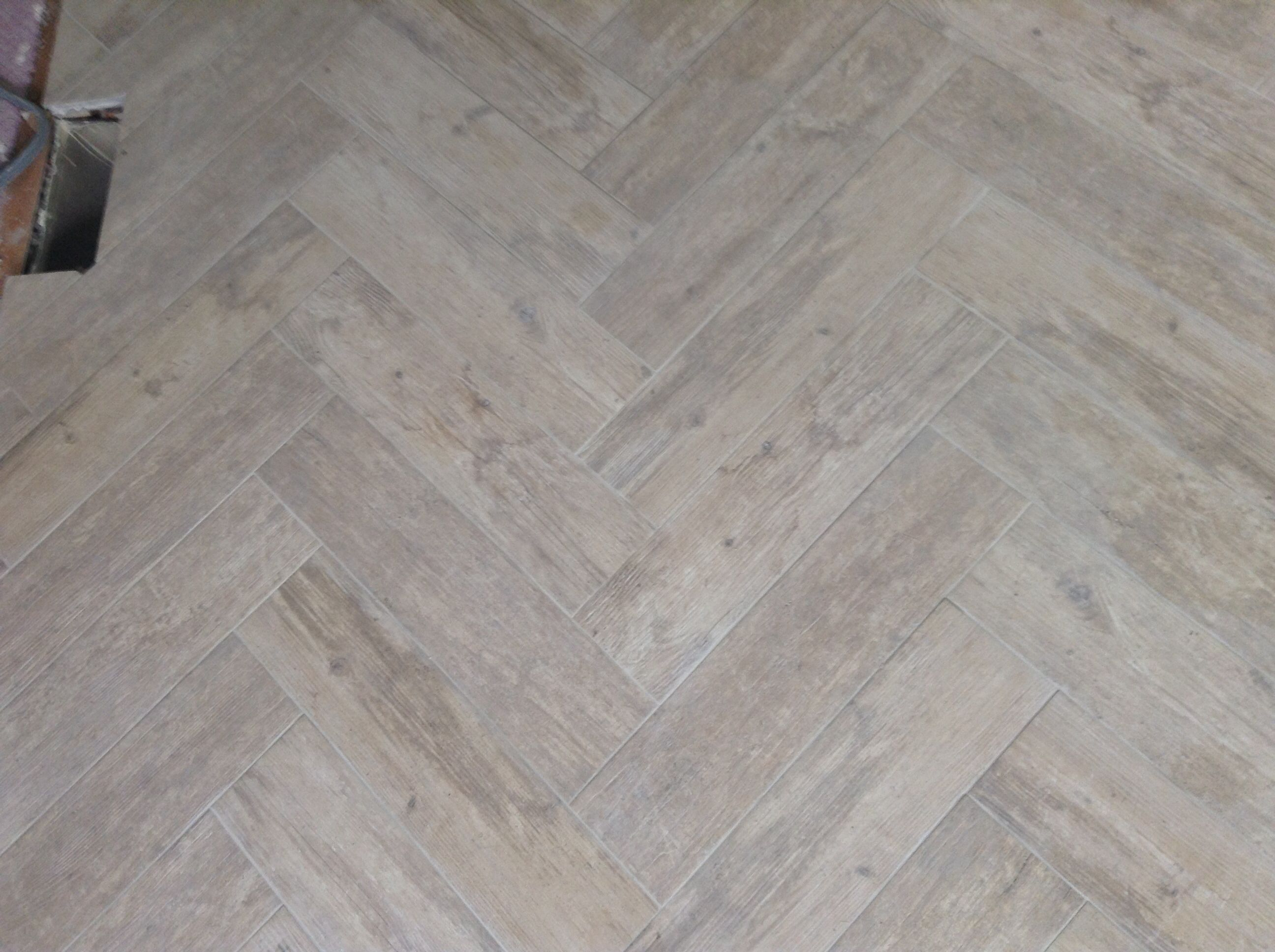 Kitchen floor chevron porcelain wood tile Oyster gray grout from
