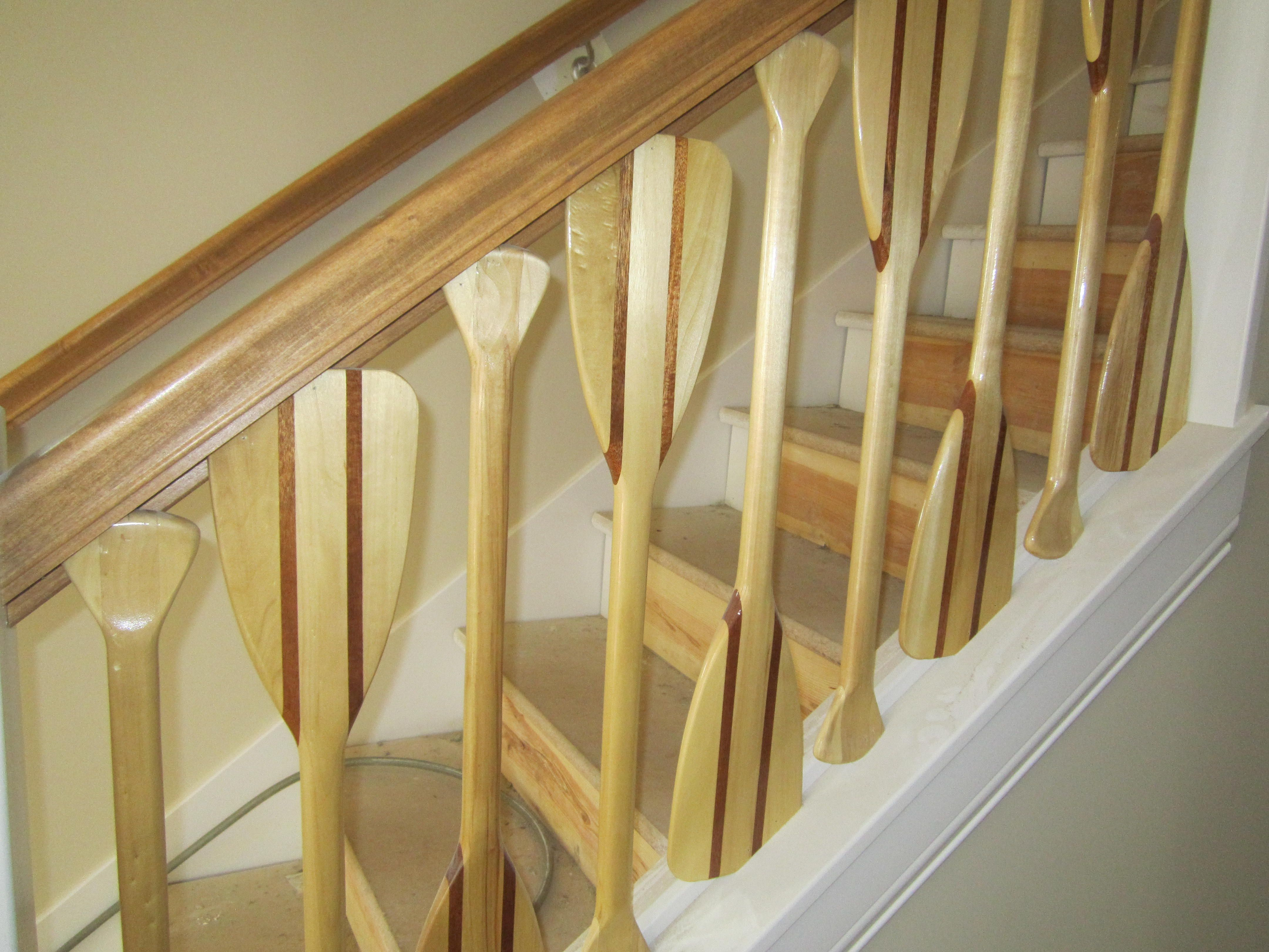 Stair railing created from canoe paddles | Cool stair railing ...