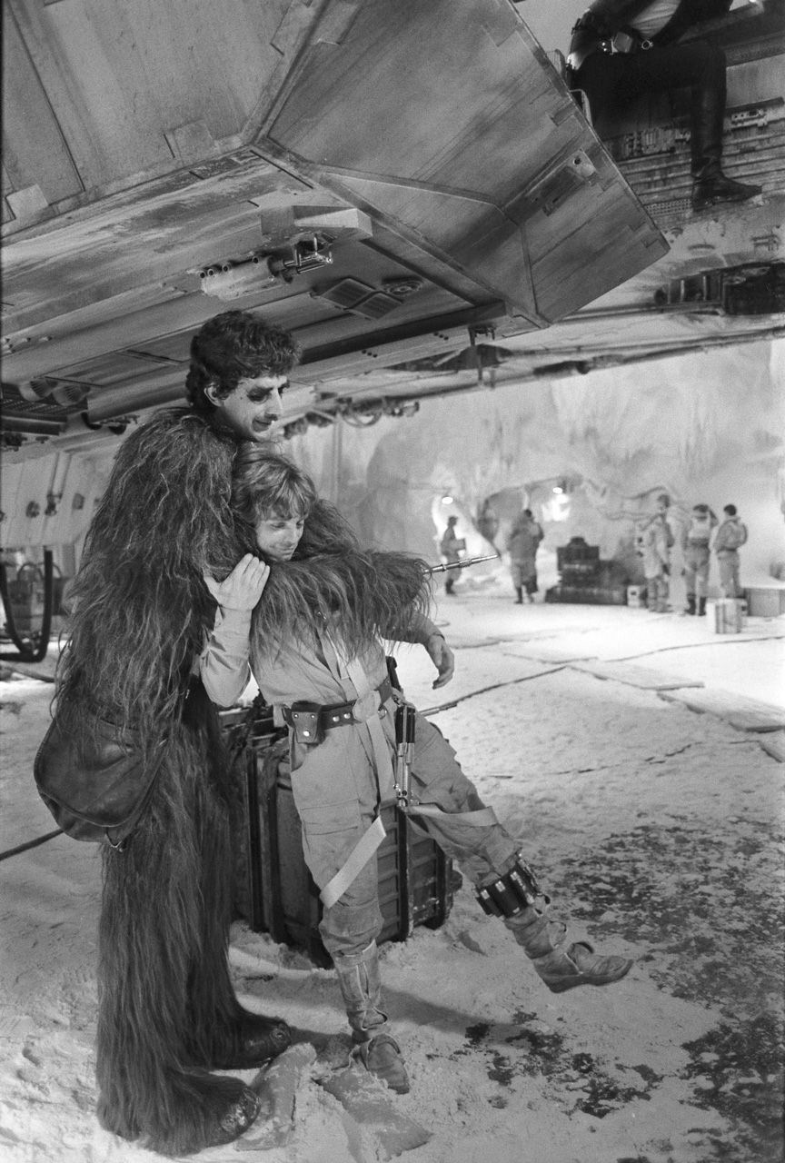 Peter Mayhew as Chewbacca gives Luke a farewell hug on