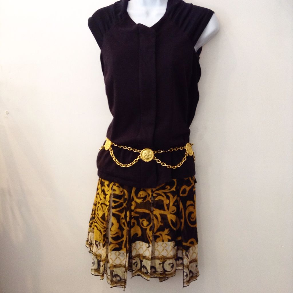 Diane Von Furstenberg silk gold and black pleated skirt with uneven hem. Paired with satin and cotton Young and Fabulous black long sleeve top. Size 4. Please call (949) 715-0004 for all inquiries.