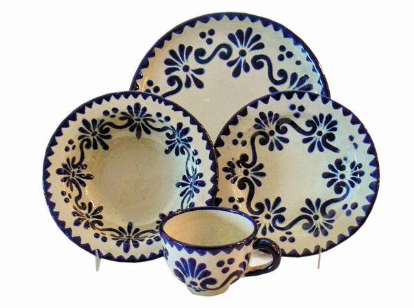 The Azul y Blanco Talavera 4-piece place setting, featuring delicate swirls of deep blue color, is a beautiful dinnerware set offers everything you need for your perfect place setting: