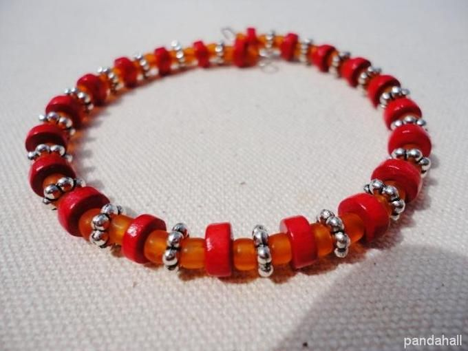 red beaded bracelet with glass seed beads and wood beads