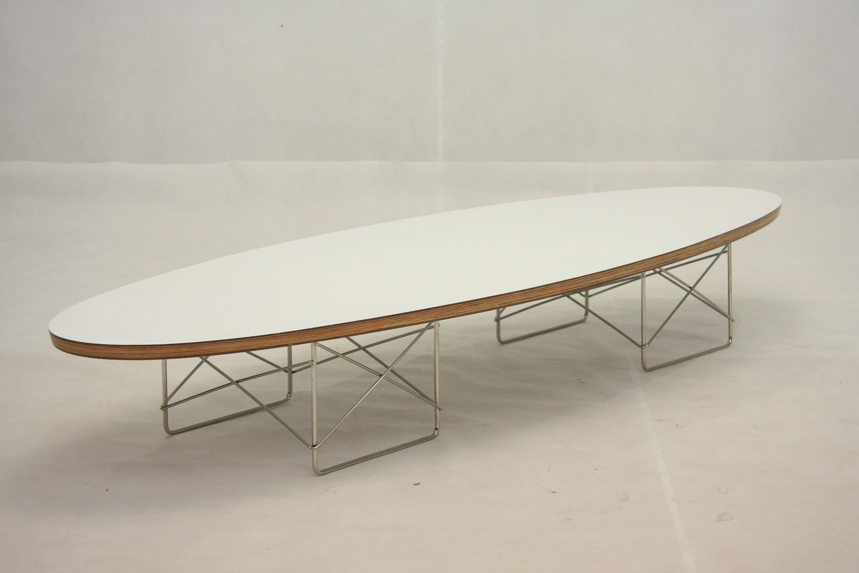 Eames Elliptical Table Sort Of Like A Skateboard On Steroids This Signature Eames Coffee Table Sculpture Is Eames Coffee Table Coffee Table Replica Furniture [ 1880 x 2816 Pixel ]