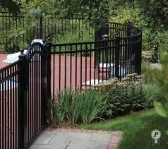 Curved pool fence and feature gate.
