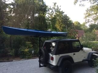 Kayak Mounted On A Soft Top Jeep Wrangler With The Hitchmount Rack