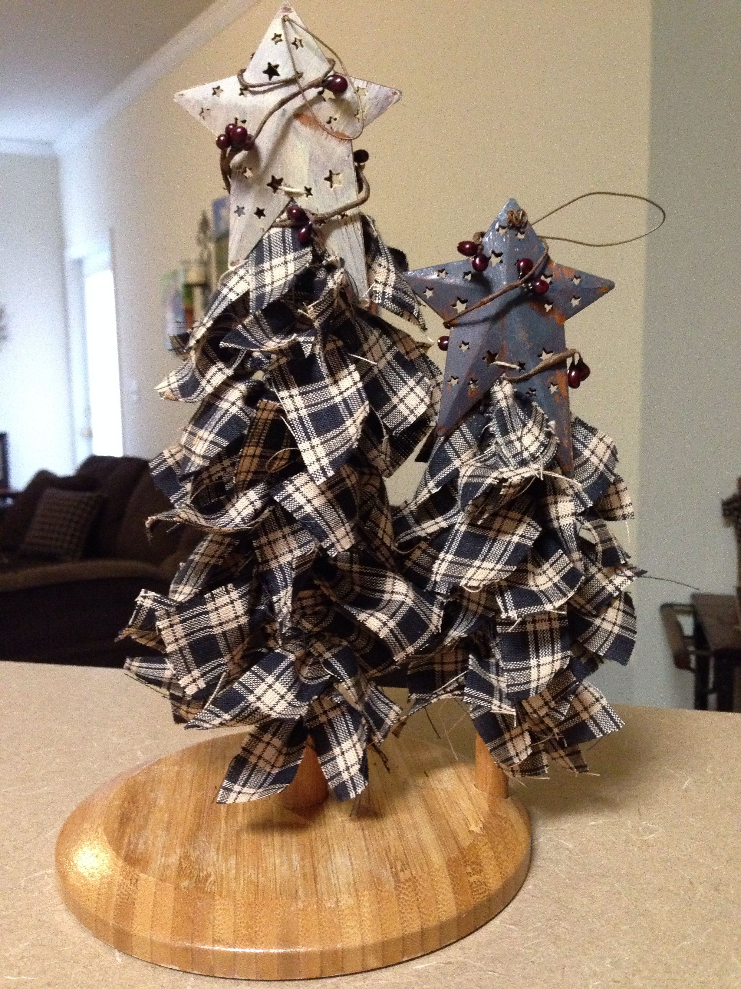 Recycled paper towel holder and some homespun fabric :) I love how it turned out. These Christmas trees fit nicely with my primitive decor!