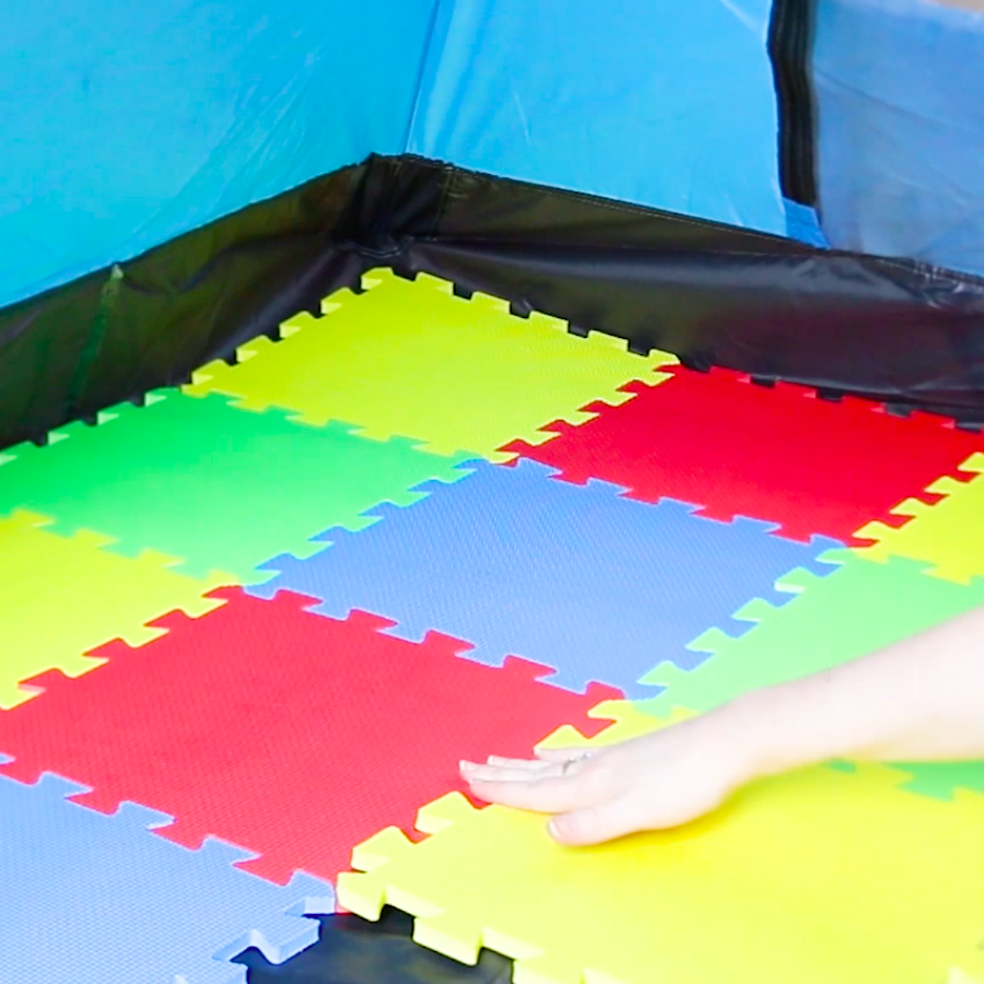 Photo of Cover the floor of your tent with foam squares for some squishy comfort.