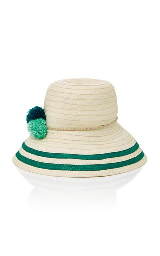 16a5895372a Sophie Anderson s straw hat has been hand-woven by the Wayuu people of  Colombia. This  Palomino  style has a wide brim and is topped with playful  pompom ...