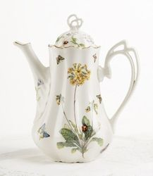 Butterfly Teapot. Butterflies playfully flutter around flowers and a lady bug on this charming porcelain teapot. The ornate handle and final and gold trim make this a charming addition to any collection.