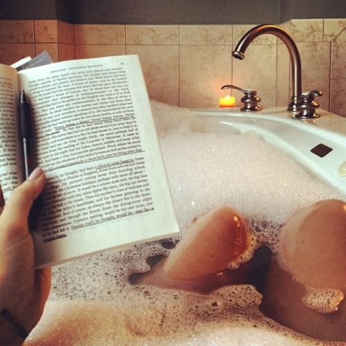 reading in the bath, maybe with pen to highlight special things or ...