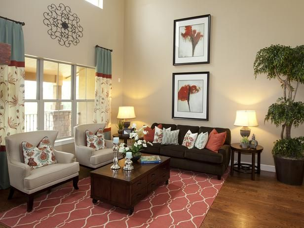 Touch of Coral Living Room Furnishings: A coral-colored rug pulls ...