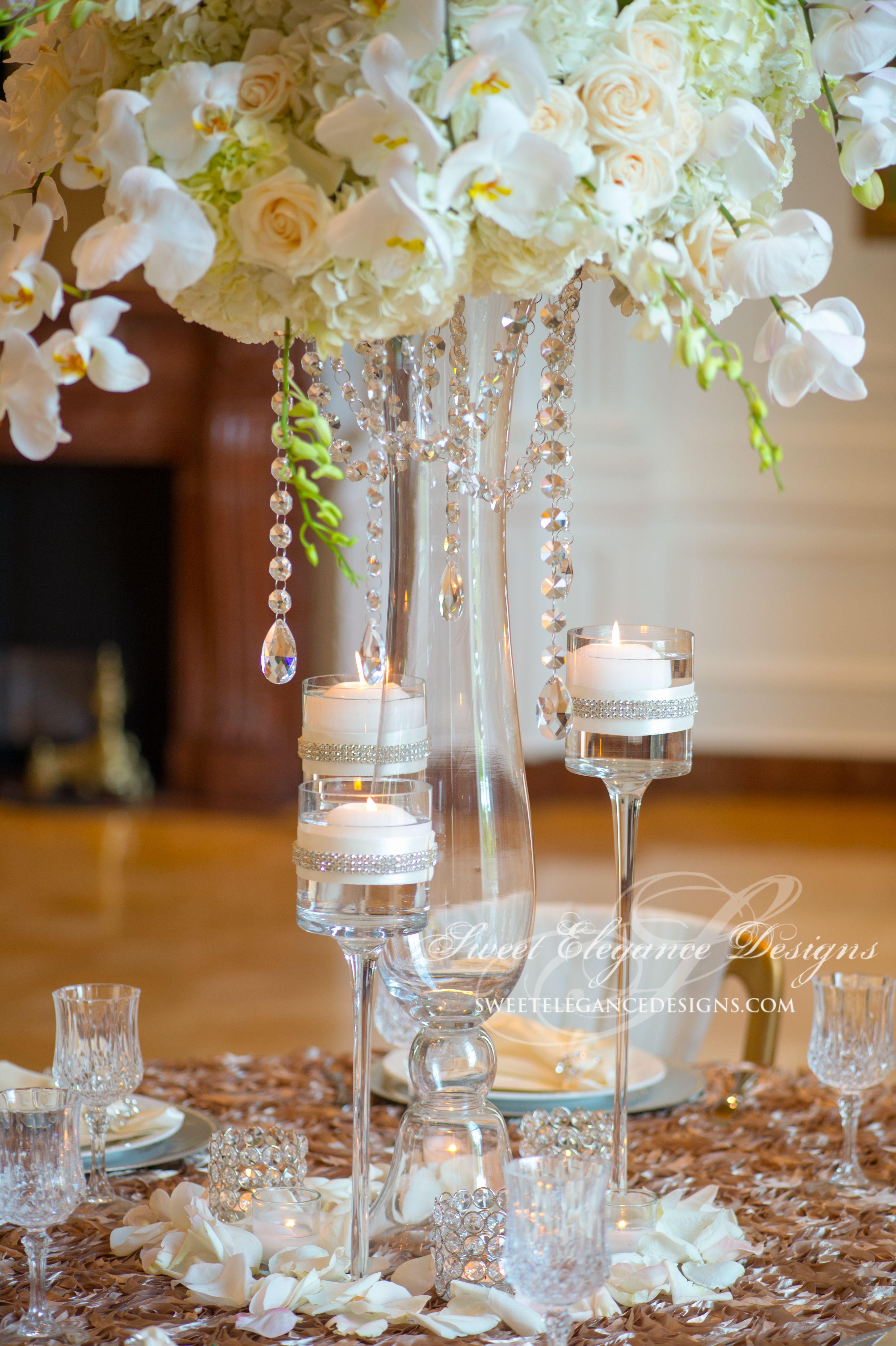 white centerpiece, crystal garland centerpiece, elegant wedding, crystal  long stemmed votives, crystal