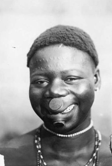 Africa | The smile of a Lobi woman. Gaoua, Haute Volta. || Vintage postcard; publisher Volta. (No 115 - CPA Gaoua Le sourire de la femme lobi)