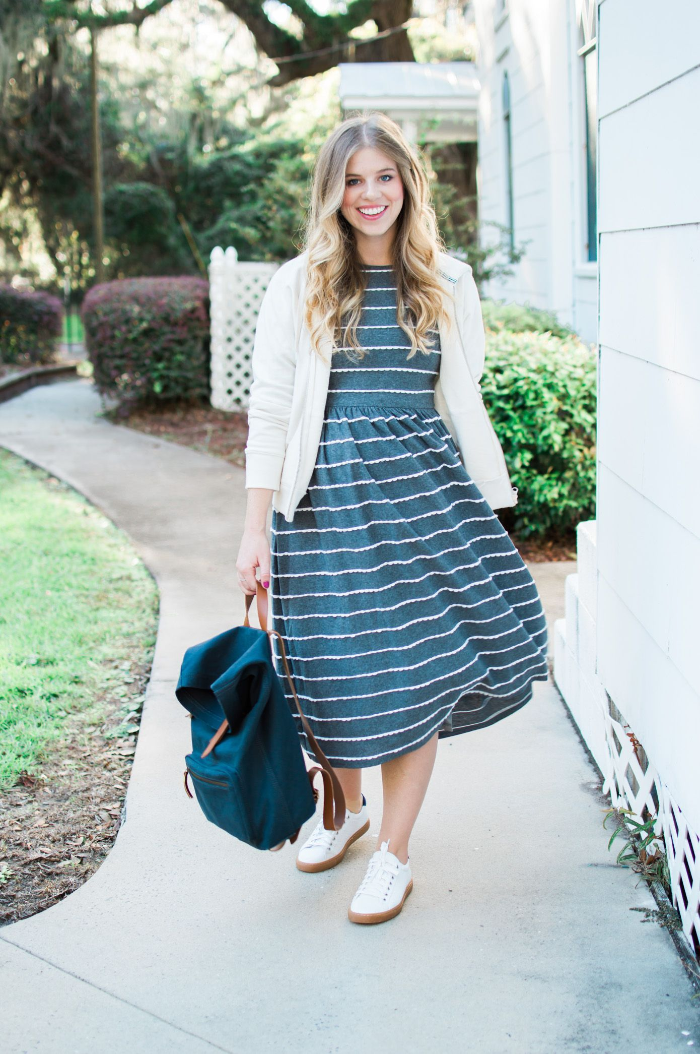 Blogger Laura Leigh styles a casual stripe midi dress for fall ...