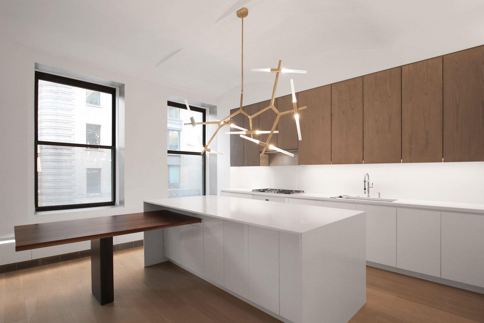 Res4 Modern Apartment Renovation Near Union Square Nyc Is An Exercise In Tiny Living The Cust Apartment Architecture Apartment Renovation Clean Kitchen Design