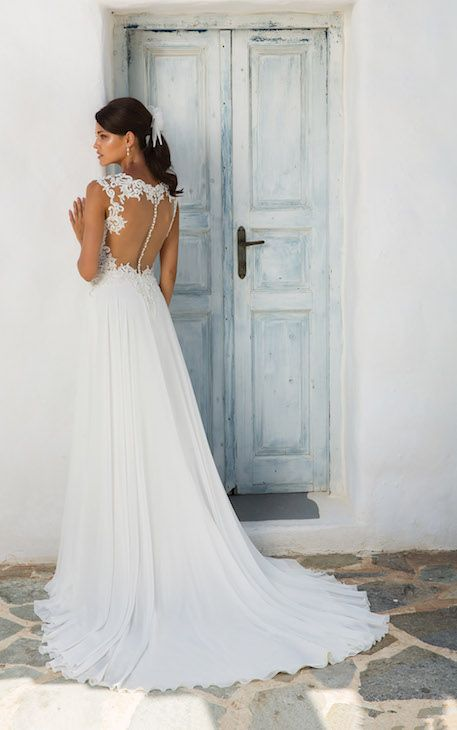 Illusion lace back wedding dress with fabric buttons and flowy skirt ...