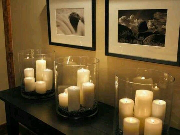 Dollar store pillar candles and hurricane love this look