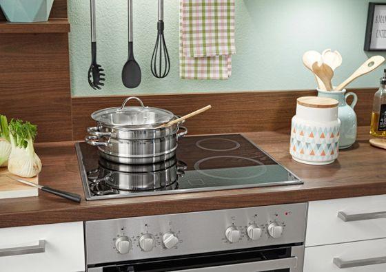Eckküche in Hellgrau und Walnuss - eine Küche zum Wohlfühlen