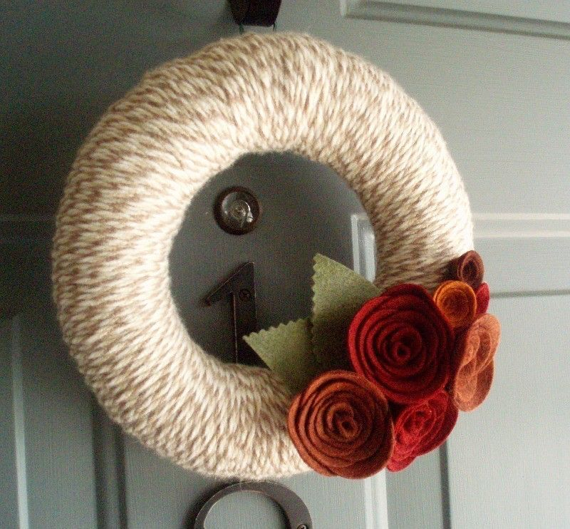 Yarn Wreath Felt Handmade Door Decoration - Lovely 8in by ItzFitz on Etsy https://www.etsy.com/listing/62768320/yarn-wreath-felt-handmade-door