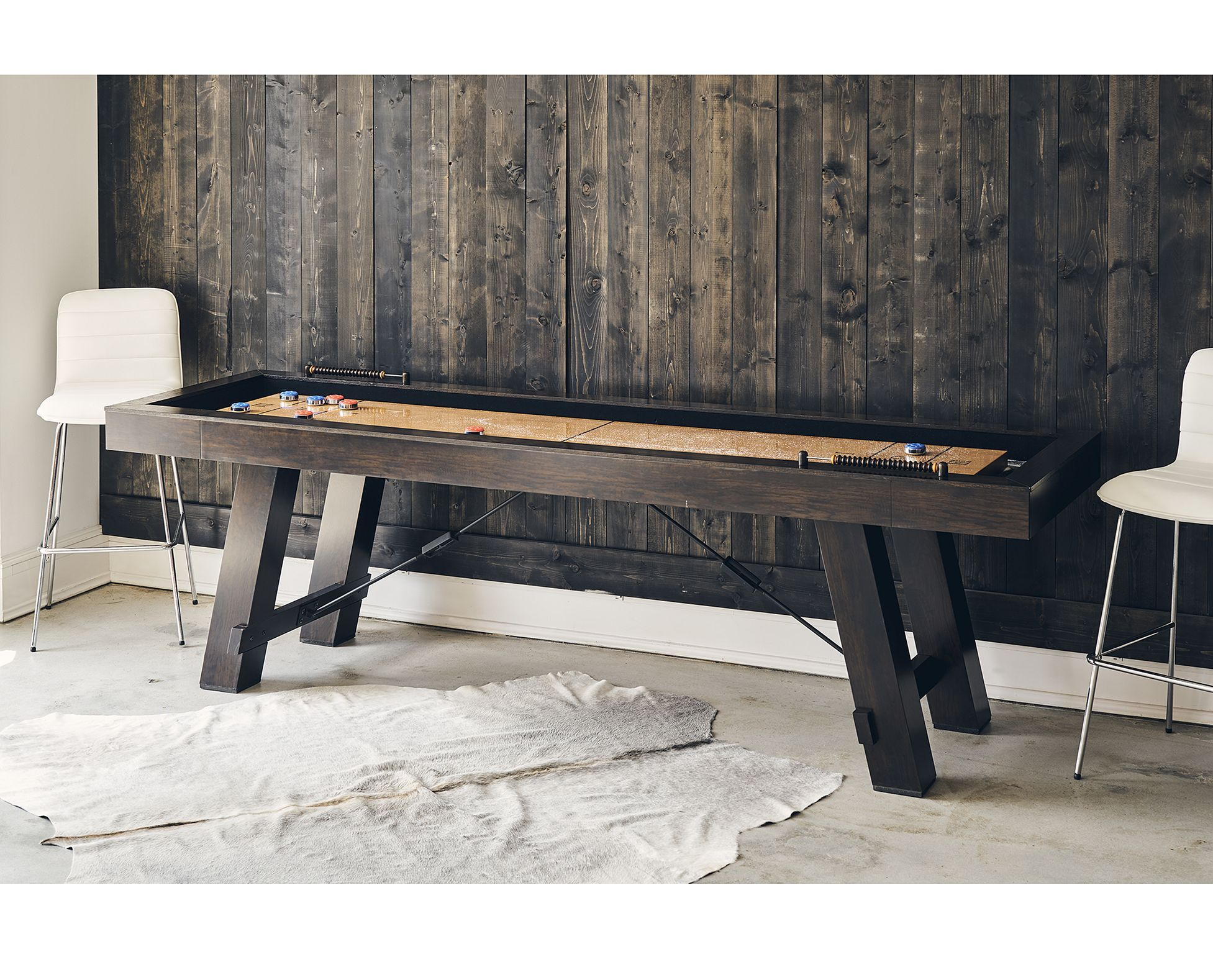 The Titus Shuffleboard Table Adds Fun To Your Family Recreation Room Den Or Basement Furniturerow Gamer Shuffleboard Table Rowe Furniture Game Room Decor