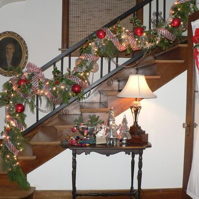 Decorate a stair rail with mesh ribbon mesh for Stair railing decorated for christmas